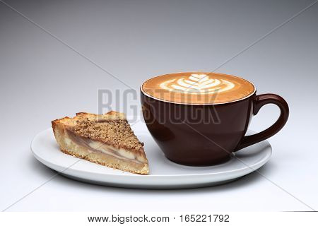 Cup Of Cappuccino And A Piece Of Cake. Latte Art. Gray Background