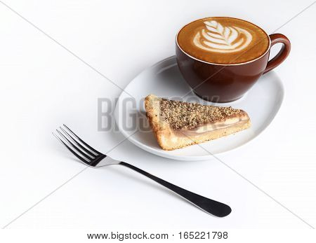Cup Of Cappuccino And A Piece Of Cake. Latte Art. Isolated On White