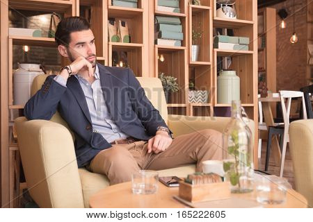 Young Man Indoors Sitting Interior Coffee Bar