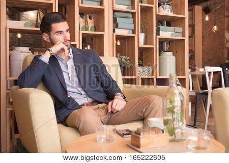 Young Man Indoors Sitting Interior Coffee Bar