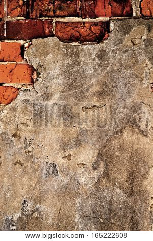 Brick, brick wall texture, brick wall background. Grunge wall. Grunge brick background. Old plaster on a brick wall.