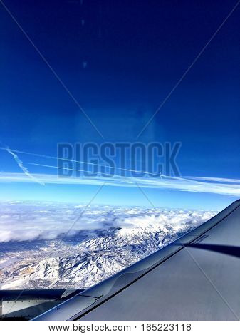 aerial view of winter snow covered rocky mountains