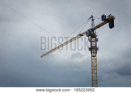 a crane in cloudy sky background photo taken in Jakarta indonesia java