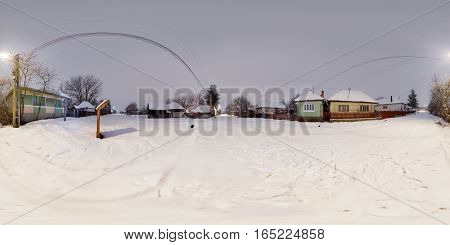 360 panorama of a rural winter landscape with combined nighttime-daytime exposures in a snow-covered Mikháza (Călugăreni), Romania