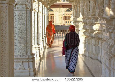 AHMEDABAD, GUJARAT, INDIA - DECEMBER 21, 2013: Two women walking in a jain temple