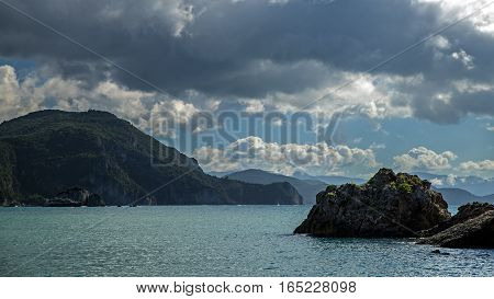 Rocky coast in the town of Parga, Ionian Sea, Greece