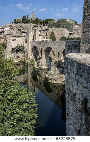 Spain Catalonia Girona Besalu. The first mention of the castle Besalu around which the town was formed refer to the tenth century . Castle towers over the hill where lie since the early Middle Ages the remains of Saint Mary .