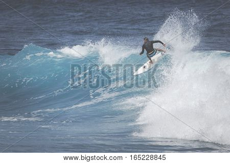 Maui, Hi - March 10, 2015: Professional Surfer Rides A Giant Wave At The Legendary Big Wave Surf Bre