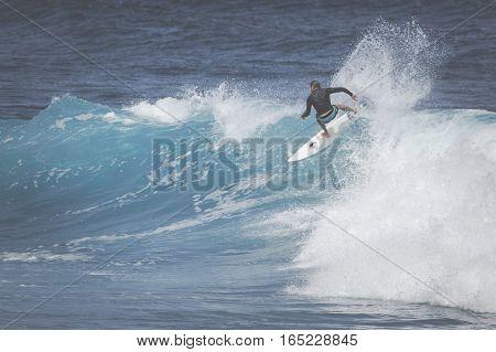 Maui, Hi - March 10, 2015: Professional Surfer Rides A Giant Wave At The Legendary Big Wave Surf Bre