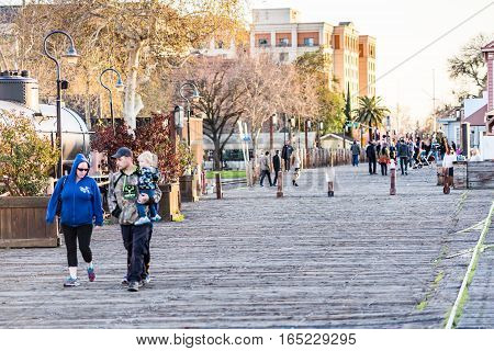 Sacramento, USA - February 20, 2016: People walking on boardwalk in downtown