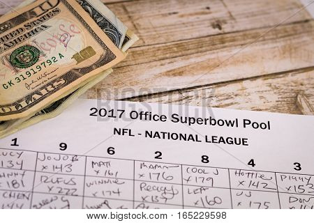 2017 Office Superbowl Pool with money on a wooden table