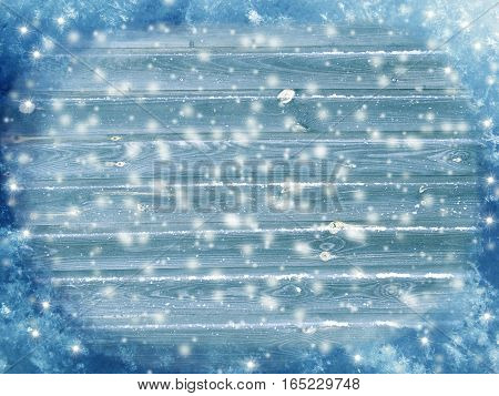 christmas background on blue wooden board with snow