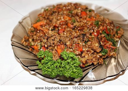 A hot dish from buckwheat and meat for dinner