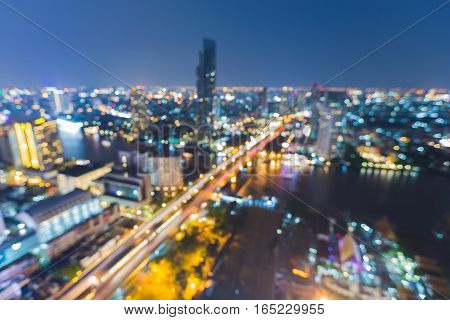 Arerial view blurred lights Bangkok city downtown night view skyline abstract background