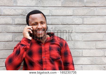 Smiling Young Black Man Talking On Mobile Phone