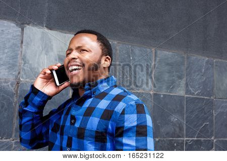 Young Man Laughing And Talking On Cellphone