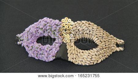 A Masquerade Eye Mask Made with Flowers and Shells.