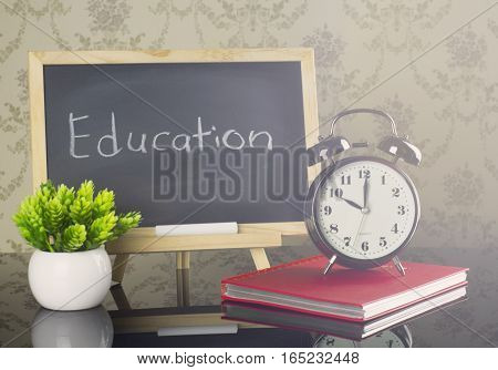 Education on blackboard with clock and flare effect