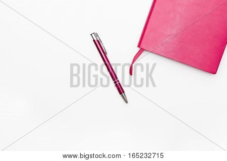 pink diary and pen on a white background business minimal concept for women. Flat lay top view.