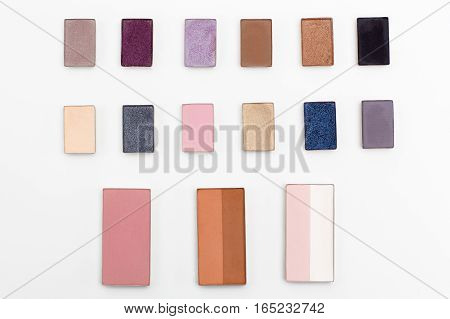 cosmetics makeup eye shadow on a white background top view. beauty flat lay concept