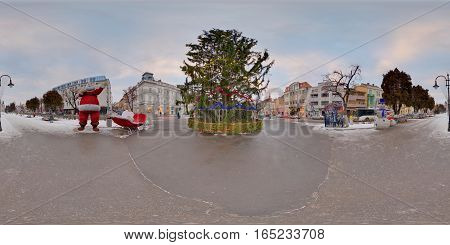 TÂRGU MUREȘ, ROMANIA - December 29, 2016: 360 panorama of a giant Christmas tree in winter daytime in a snow-covered Piața Trandafirilor (Roses' Square), town centre of Târgu Mureș, Romania