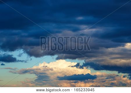 Summer evening. The blue sky rain cumulus clouds. Background