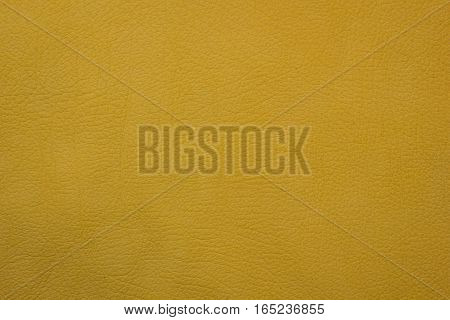 Yellow leather structured texture. design background orfey