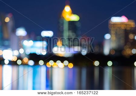 Night blurred lights Office building with reflection abstract background
