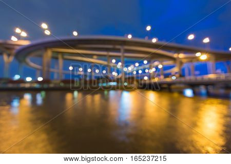 Abstract blurred lights highway interchanged with blue twilight sky background