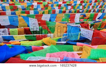 DEQIN CHINA - APRIL 2015 Coloful prayer flag in top of snow mountain at Deqin Yunnan China