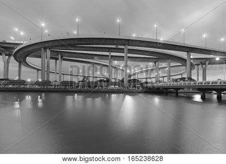 Black and White Round highway intersection river front night view
