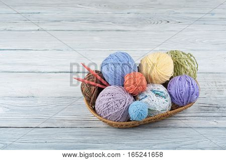 Knitted background with knitting needle and colorful balls of yarn knit is hobby leisure activities of many people in free time also make many handmade product