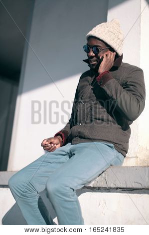 Fashion Young African Man Talking On Smartphone In The City