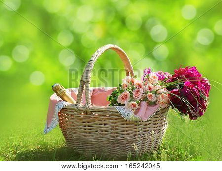 Romance, Love, Valentine's Day Concept - Wicker Basket With Bouquet Of Flowers, Bottle Wine On The G