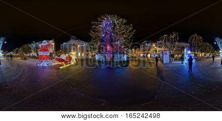 TÂRGU MUREȘ, ROMANIA - December 29, 2016: 360 panorama of a giant Christmas tree lit up at night in a snow-covered Piața Trandafirilor (Roses' Square), town centre of Târgu Mureș, Romania