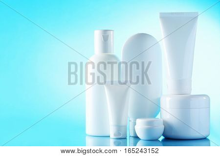 White Cosmetic Bottles On A Blue Background