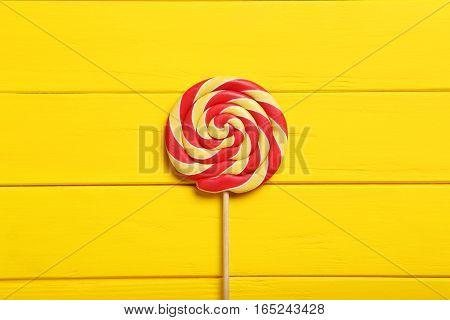 Sweet Lollipop On A Yellow Wooden Table
