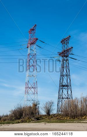 High voltage transmission tower and lines. Energetics concept.