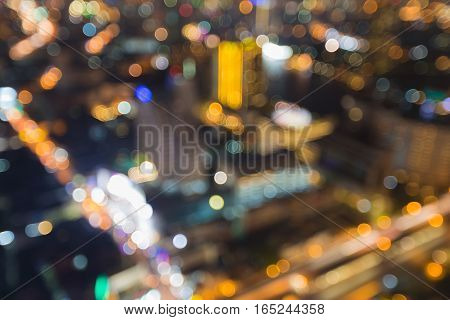 Blurred lights night view Bangkok city downtown aerial view.