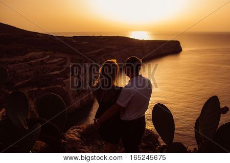 Couple In The Evening On The Seaside