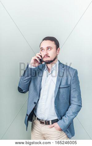 Man talking on the phone. Businessman talks.