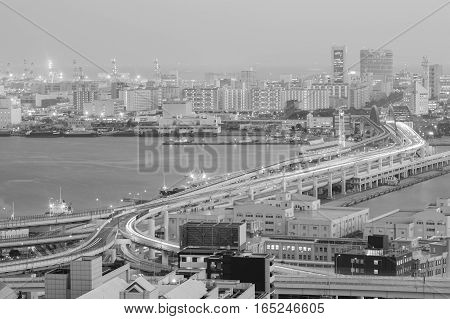 Black and White Kobe city road aerial view over sea port at twilight Japan