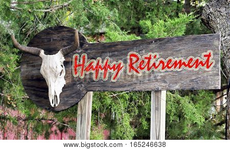 Happy retirement sign with old  cow skull.