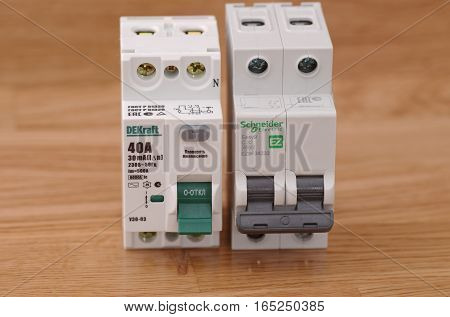 SARANSK, RUSSIA - JANUARY 13, 2017: DEKraft residual-current device and Schneider Electric two-pole circuit breaker.