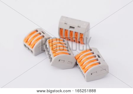 Close up Compact Splicing Connectors on white background. poster