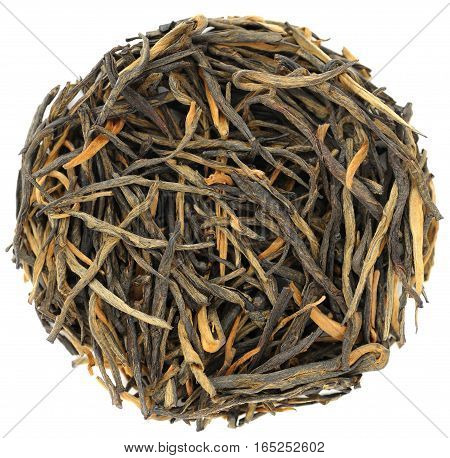 Yunnan wild arbor chinese black tea in round shape isolated closeup