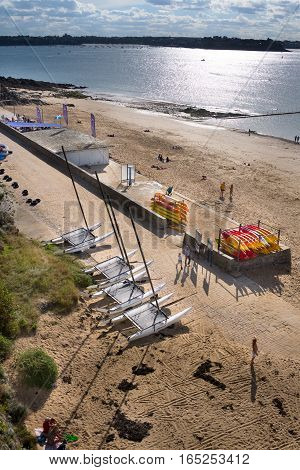 Group of catamarans and kayaks after ocean sailing on beach Bon Secours in Saint-Malo, Bretagne France