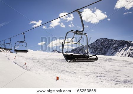 Empty Ski Chair Lift On Sunny Day In Alps, Austria