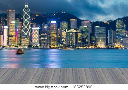 Opening wooden floor blurred lights Hong Kong city sea front with twilight sky background