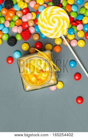 Assorted Colorful Candies Fallen Out Of Jar